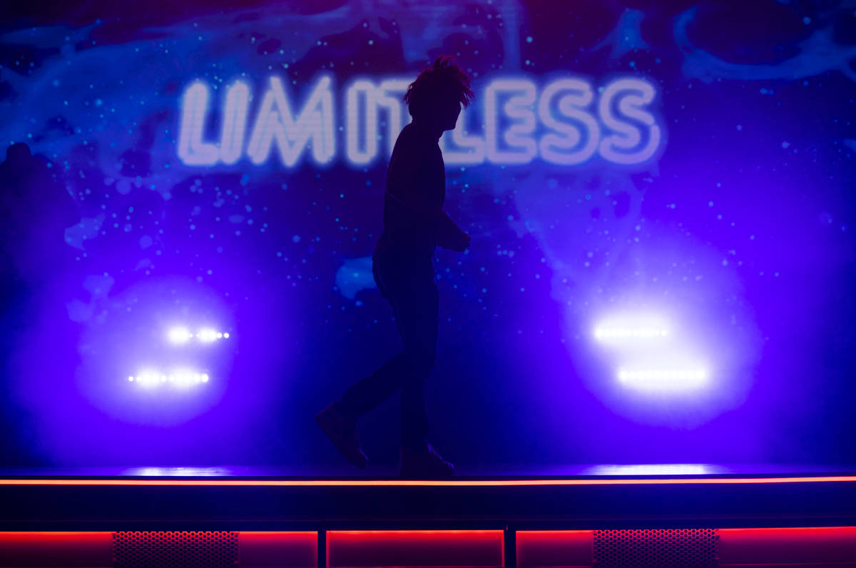 """Illusionist Shin Lim is silhoutted onstage ahead of the reopening of his show, """"Limitless, ..."""