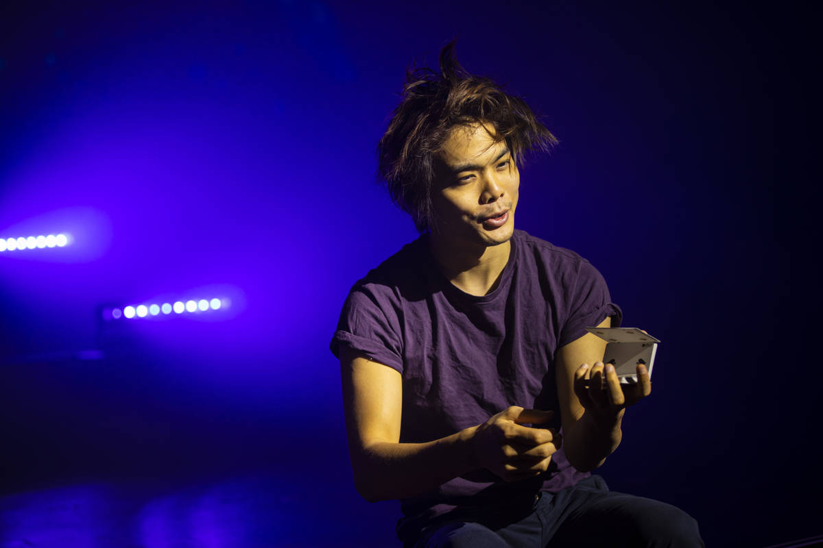 """Illusionist Shin Lim performs tricks onstage ahead of the reopening of his show, """"Limitl ..."""