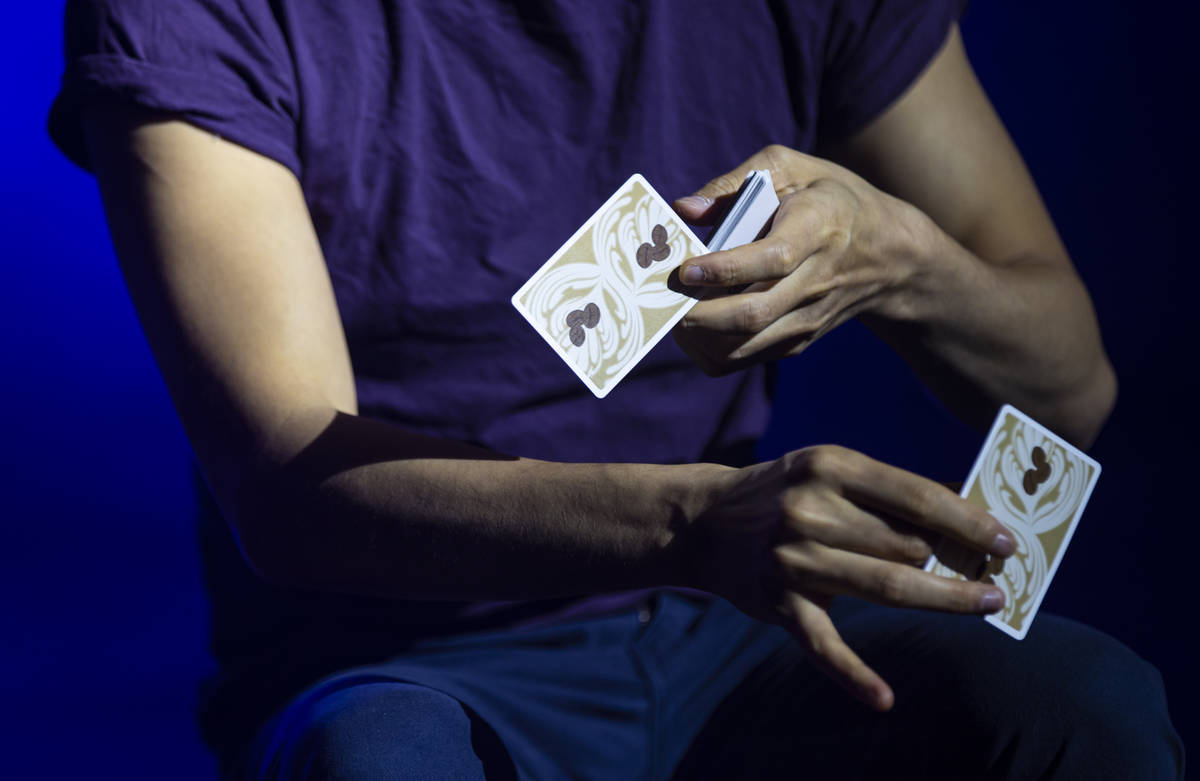 """Illusionist Shin Lim performs card tricks onstage ahead of the reopening of his show, """"Lim ..."""