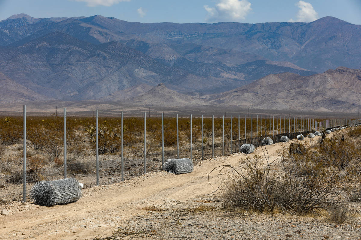 A fence to the future Yellow Pine solar project, a solar farm under construction that will cove ...
