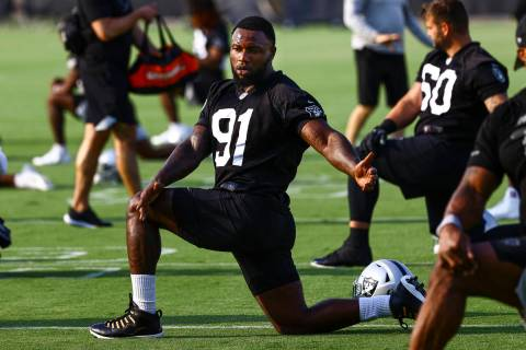 Raiders defensive end Yannick Ngakoue (91) stretches during an NFL football minicamp at Raiders ...