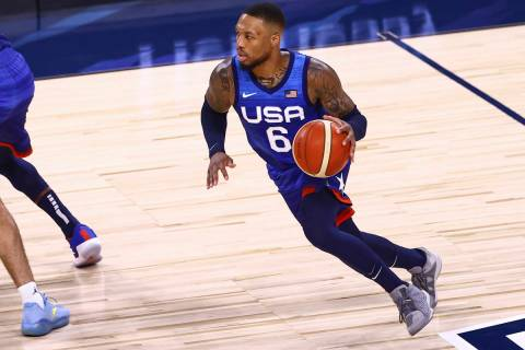 USA's Damian Lillard (6) brings the ball up court against Argentina during the first half of an ...