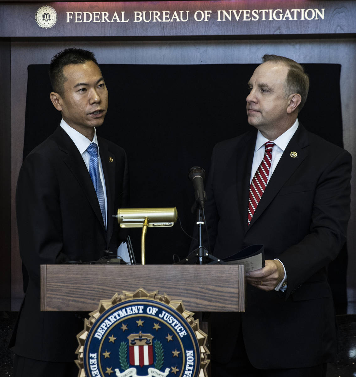 Acting U.S. Attorney Christopher Chiou, left, speaks about a global law enforcement action as S ...