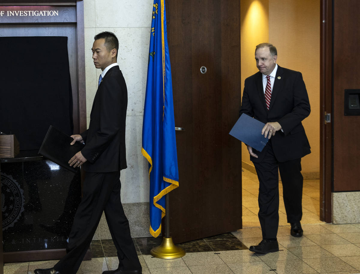 Acting U.S. Attorney Christopher Chiou, left, and Special Agent in Charge Aaron Rouse of the FB ...