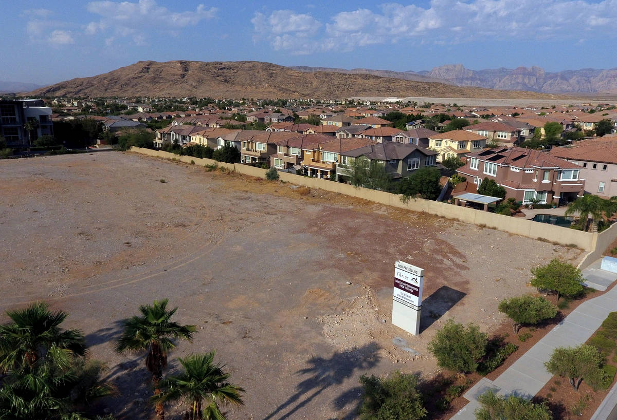 A vacant parcel of land that is slated to get a townhouse project called Thrive is shown, on Th ...