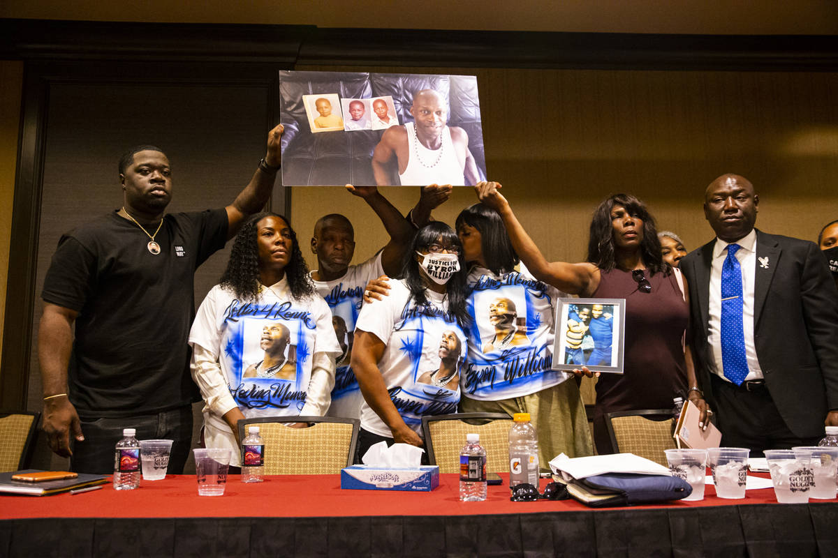 Family members of Byron Williams, with support from the family of George Floyd, chant 'Byrons l ...