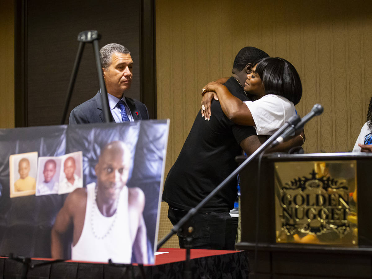 Brandon Williams, nephew of George Floyd, hugs Robyn Williams before a news conference announci ...