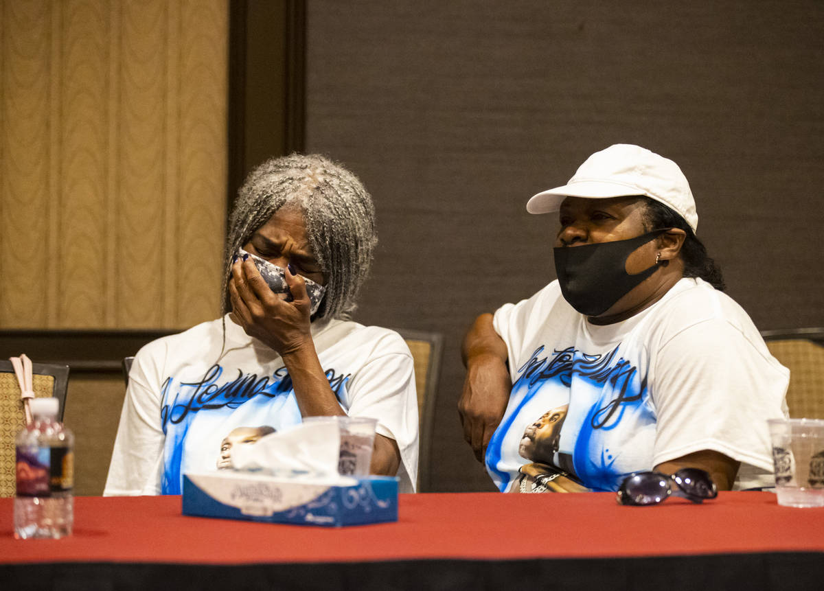 Cheryl Lewis, left, and Gwendolyn Lewis, sisters of Byron Williams, listen during a news confer ...