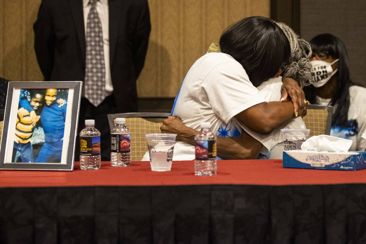 Robyn Lewis, left, and Cheryl Lewis, sisters of Byron Williams, embrace during a news conferenc ...