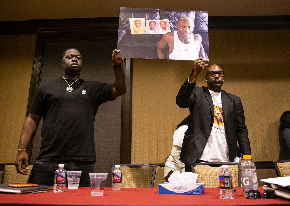 Philonise Floyd, brother of George Floyd, right, and Brandon Williams, Floyd's nephew, hold up ...
