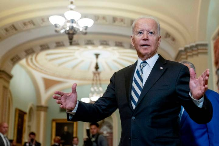 President Joe Biden speaks with members of the media after leaving a meeting with fellow Democr ...