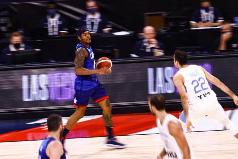 USA's Bradley Beal (4) brings the ball up court during the second half of an exhibition basketb ...
