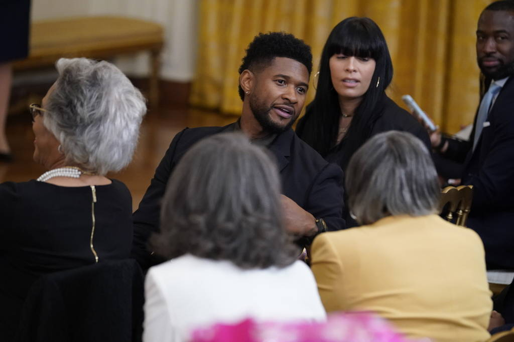 Usher is seated as he arrives for an event to mark the passage of the Juneteenth National Indep ...