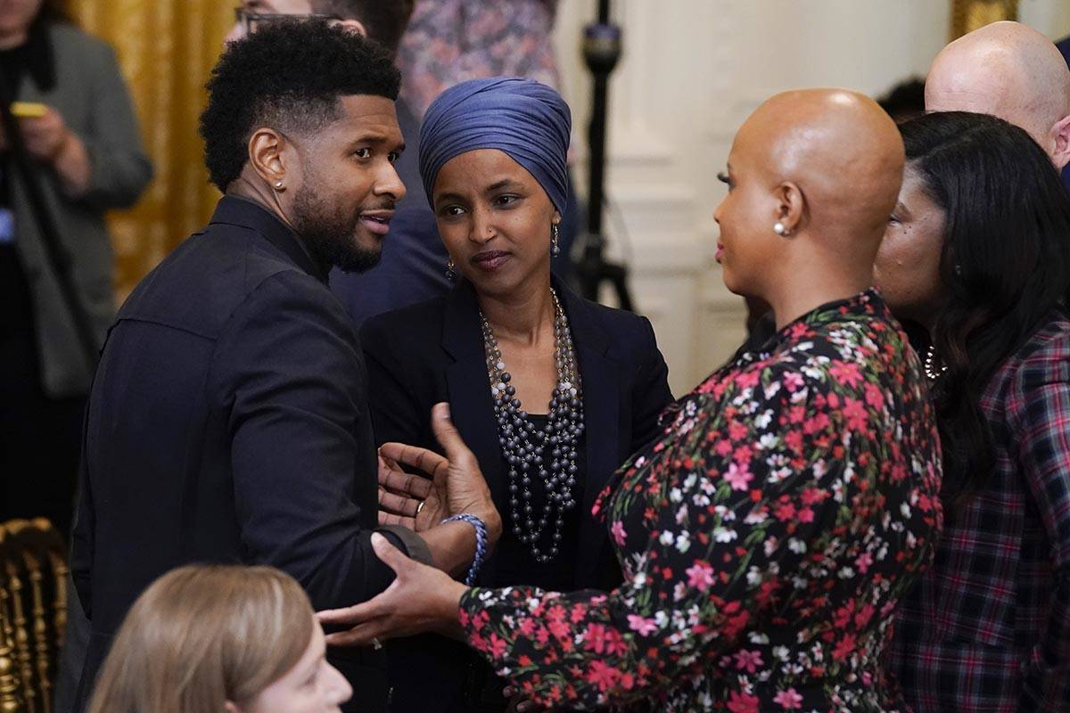 Usher speaks with Rep. Ilhan Omar, D-Minn., second from left, and Rep. Ayanna Pressley, D-Mass. ...