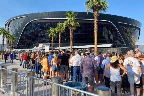 Attendees for a Garth Brooks concert line up at Allegiant Stadium about two hours before the sc ...