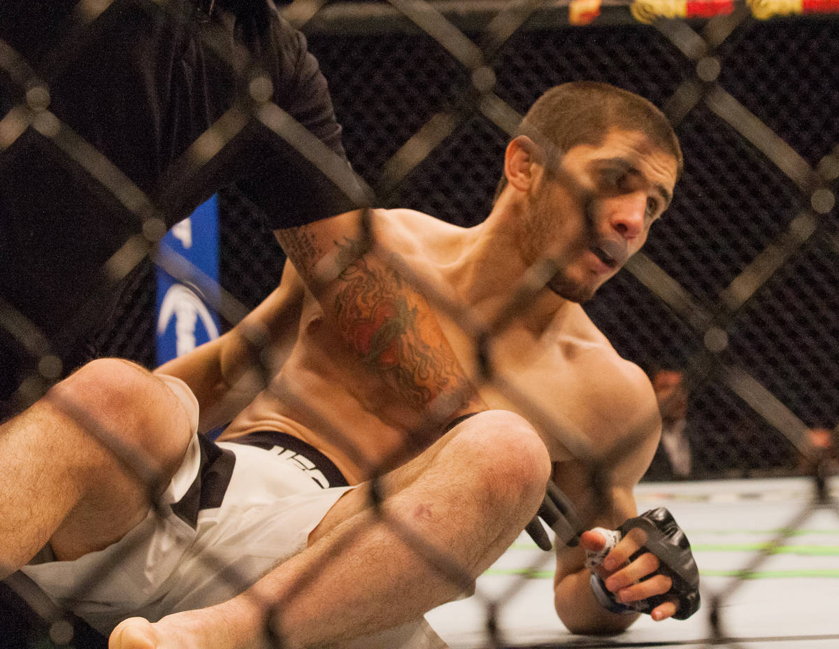 UFC fighter Islam Makhachev, is being help by the UFC medical staff in round-1 during the UFC 1 ...