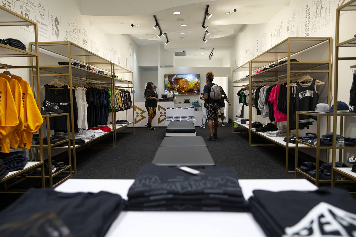 Employees ready Marshawn Lynch's store, Beast Mode, before its grand opening in The Shoppes at ...