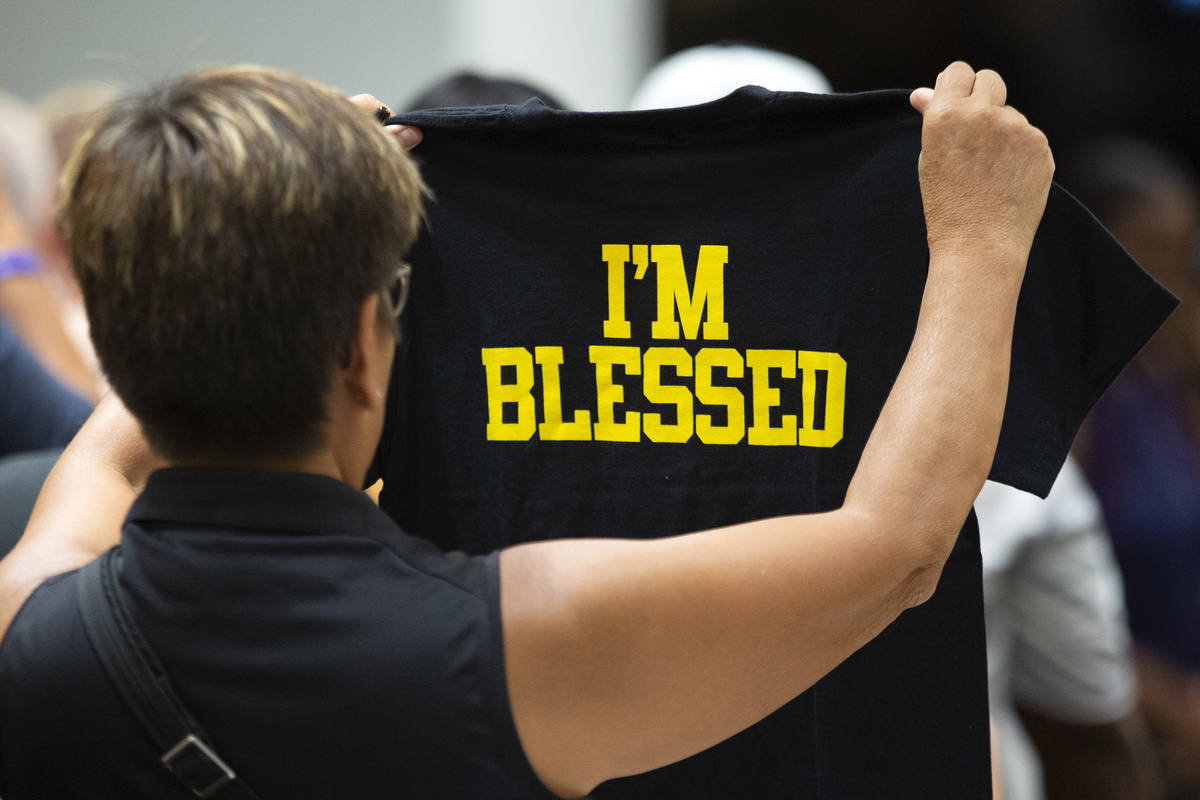 A customer checks out a t-shirt at the opening of Marshawn Lynch' store Beast Mode in The Shopp ...