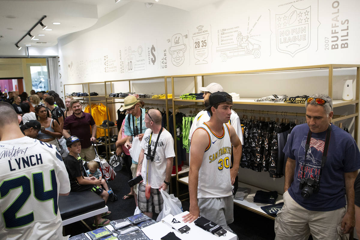Fans and customers wait in line at the opening of NFL running back Marshawn Lynch's store, Beas ...