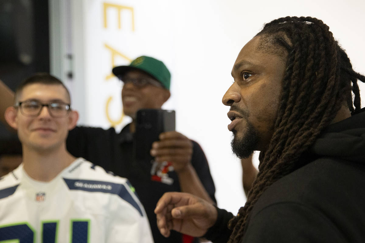 NFL running back Marshawn Lynch speaks to media at the opening of his store, Beast Mode, in The ...
