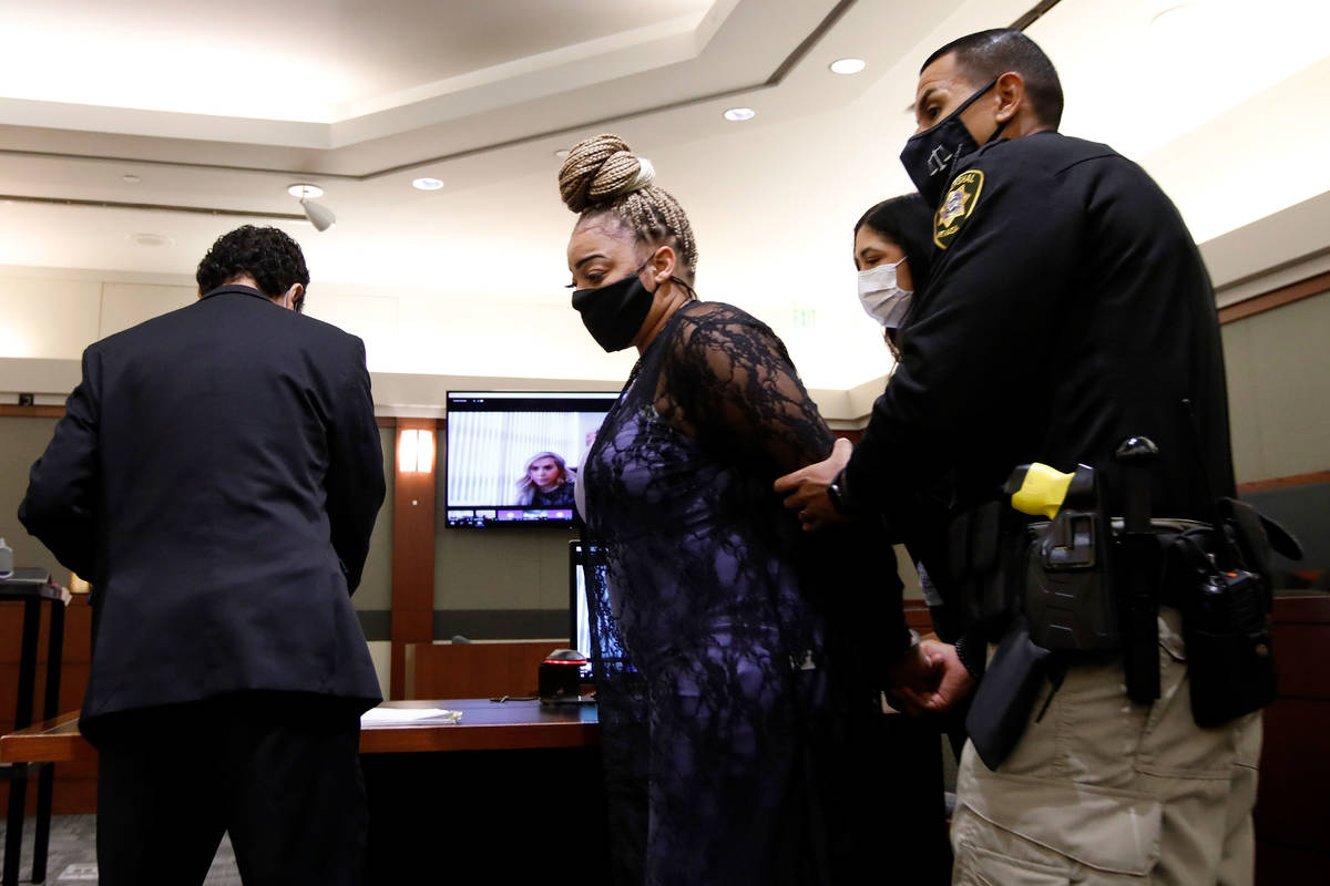 Cadesha Bishop, who is charged with pushing an elderly man off a bus before he die, is taken in ...