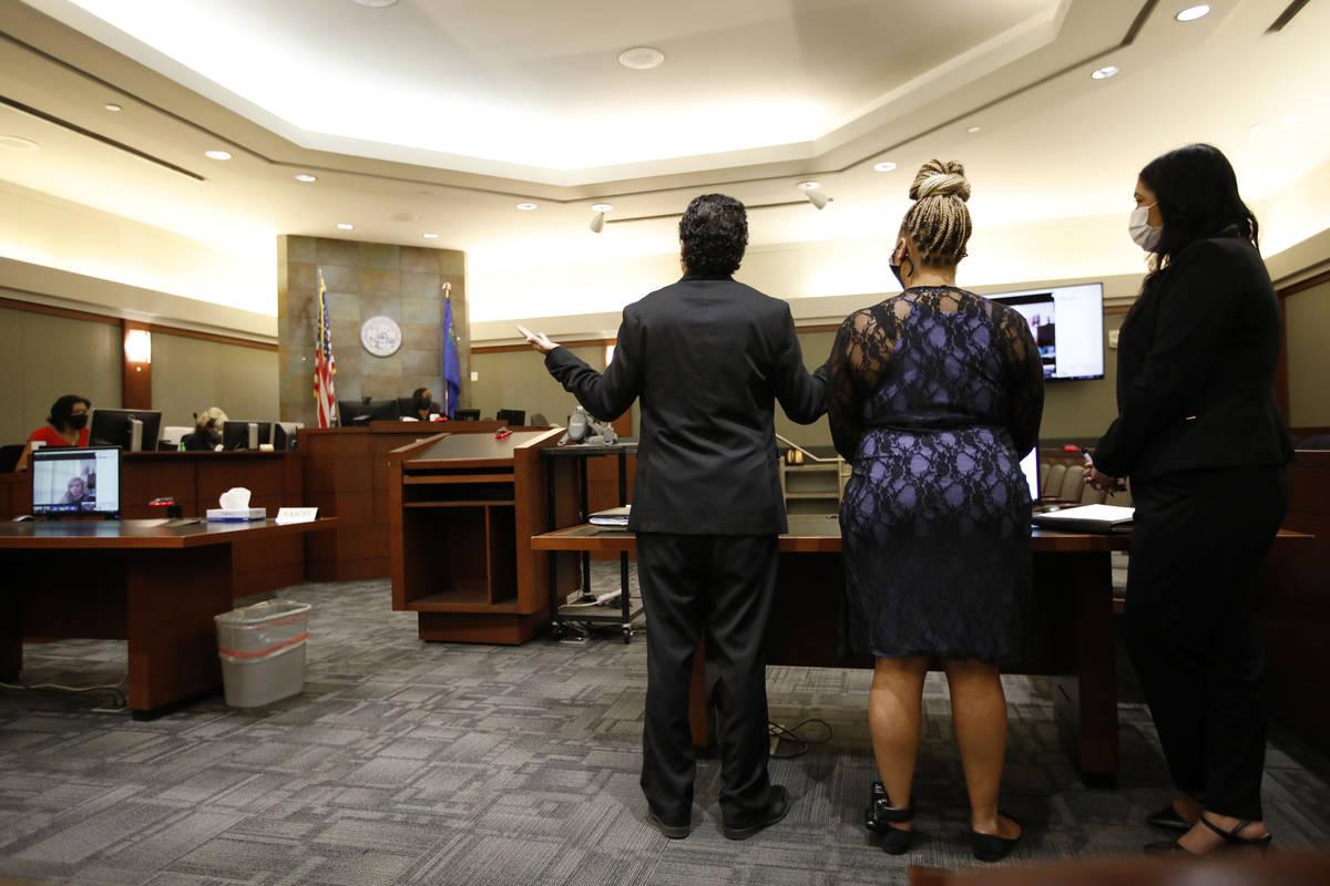 Attorney Michael Castillo, left, speaks in front of Judge Tierra Jones, background, during a ba ...