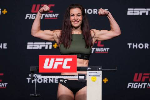 Miesha Tate poses on the scale during the UFC Fight Night weigh-in at UFC APEX on June 25, 2021 ...