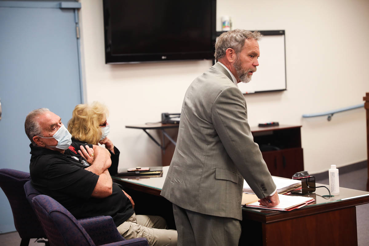 Marcel Chappuis sits with his wife Patricia Chappuis as their defense attorney Thomas Gibson sp ...
