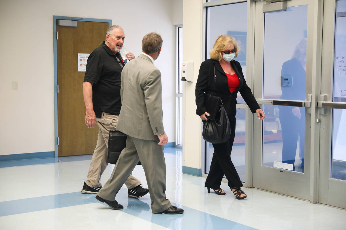 Marcel Chappuis, from left, leaves Beatty Justice Court with his attorney Thomas Gibson and wif ...
