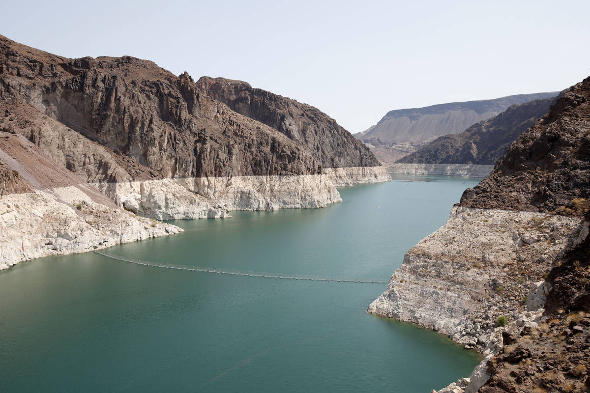 A bathtub ring of light minerals shows the high water line near Hoover Dam on Lake Mead from th ...