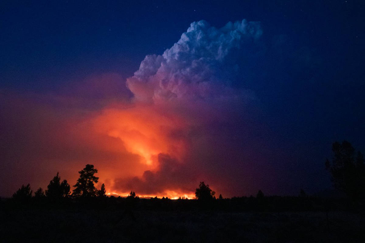 In this photo provided by the Oregon Office of State Fire Marshall, flames and smoke rise from ...