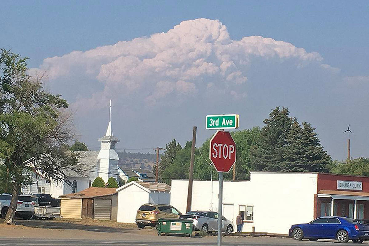 In this photo provided by the Bootleg Fire Incident Command, smoke from the Bootleg Fire rises ...
