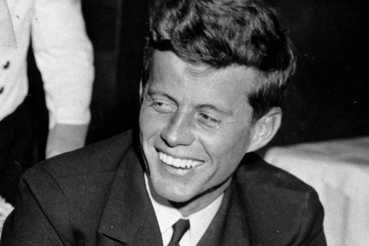 FILE - In this Feb.9,1944, file photo, U.S. Navy Lt. John F. Kennedy smiles at the Stork Club ...