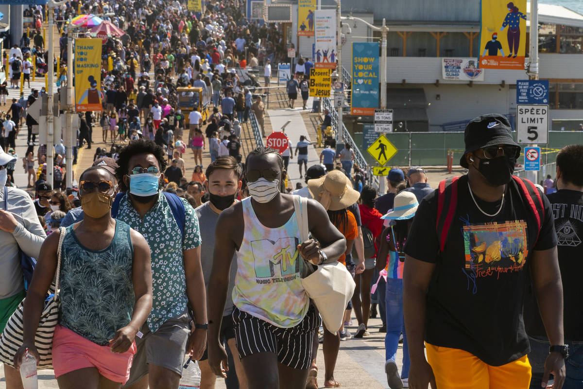 FILE - In this May 29, 2021, file photo, people crowd the Santa Monica Pier in Santa Monica, Ca ...