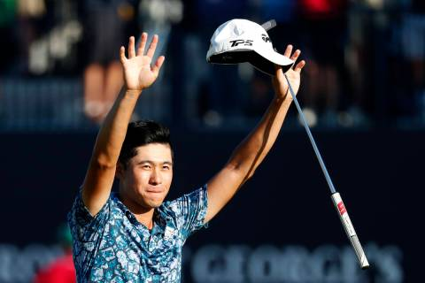 United States' Collin Morikawa celebrates on the 18th green after winning the British Open Golf ...