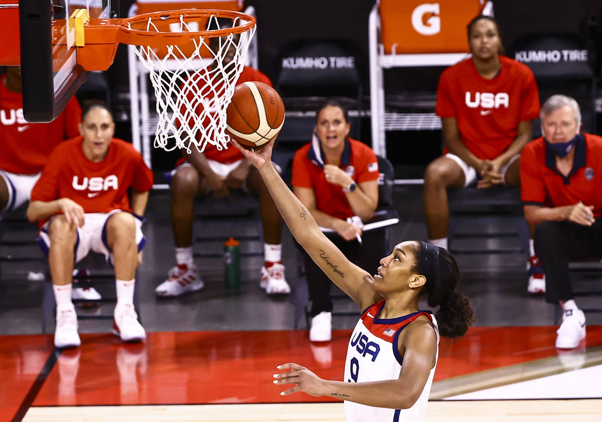 United States forward A'ja Wilson lays up the ball during the first half of an exhibition baske ...