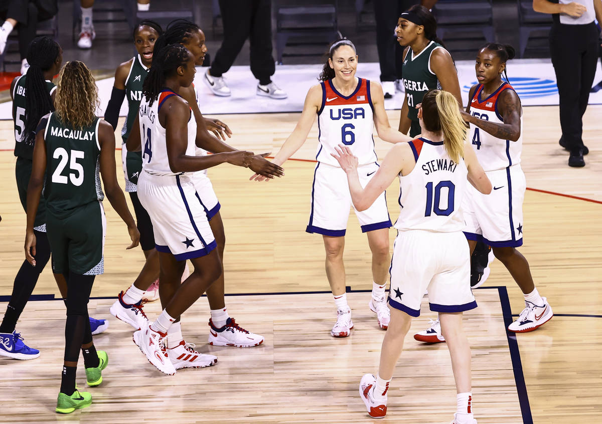 United States guards Sue Bird (6) and Jewell Loyd (4) gather with teammates during a break whil ...