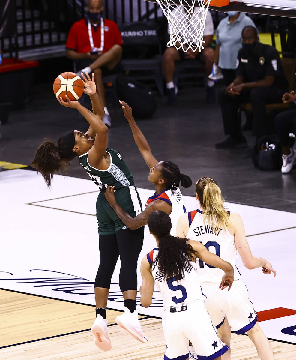 Nigeria guard Erica Ogwumike (31) shoots over United States guard Jewell Loyd during the first ...