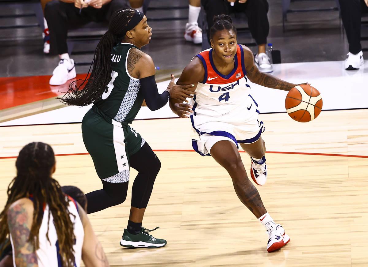 United States guard Jewell Loyd (4) moves the ball around Nigeria guard Ezinne Kalu (23) around ...