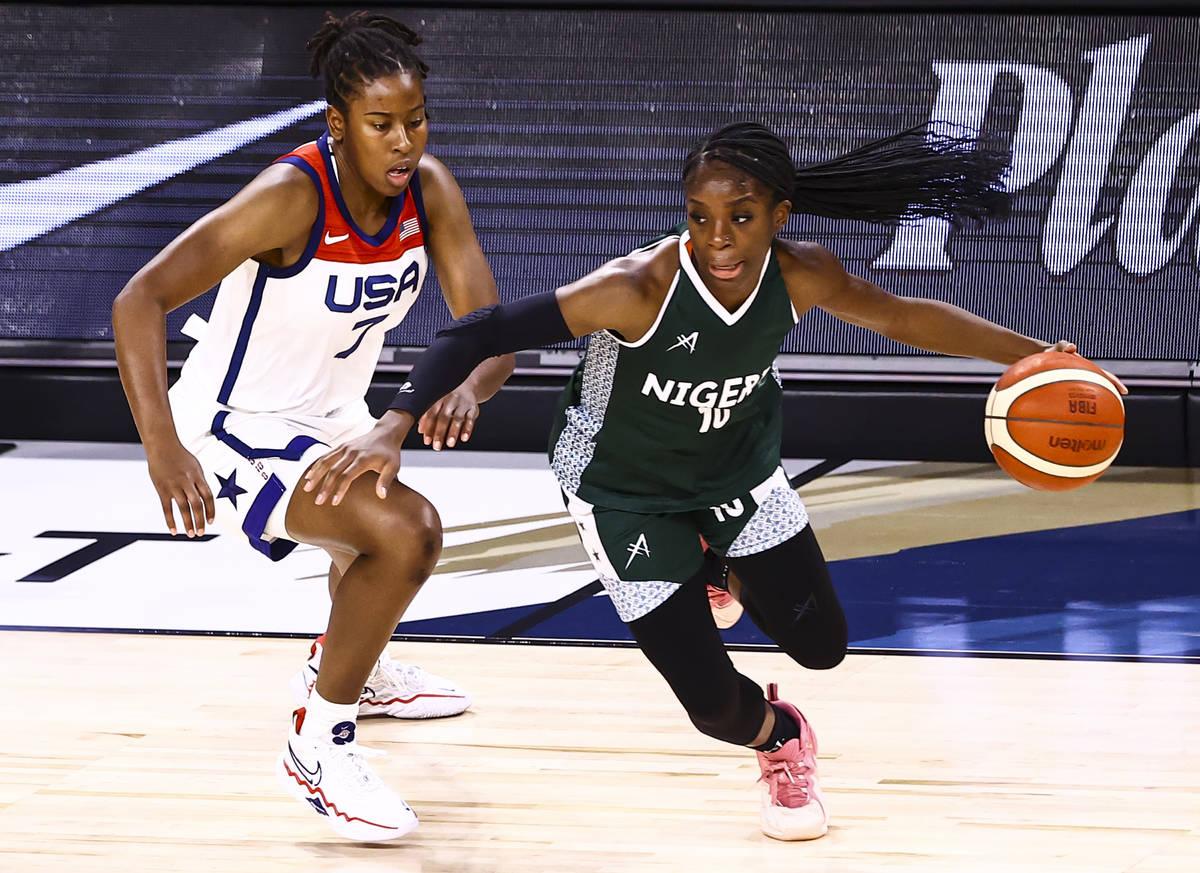 Nigeria guard Promise Amukamara (10) drives the ball around United States guard Ariel Atkins (7 ...