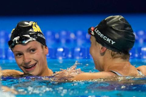 Katie Ledecky congratulates Katie Grimes after the women's 800 freestyle during wave 2 of the U ...