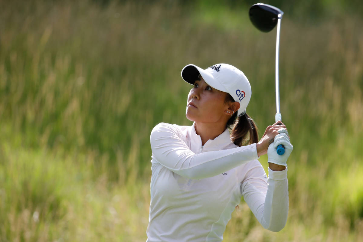 Danielle Kang watches her tee shot on the 16th hole during the quarter final round of the Bank ...