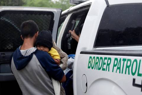 FILE - In this March 14, 2019, file photo, families who crossed the nearby U.S.-Mexico border n ...