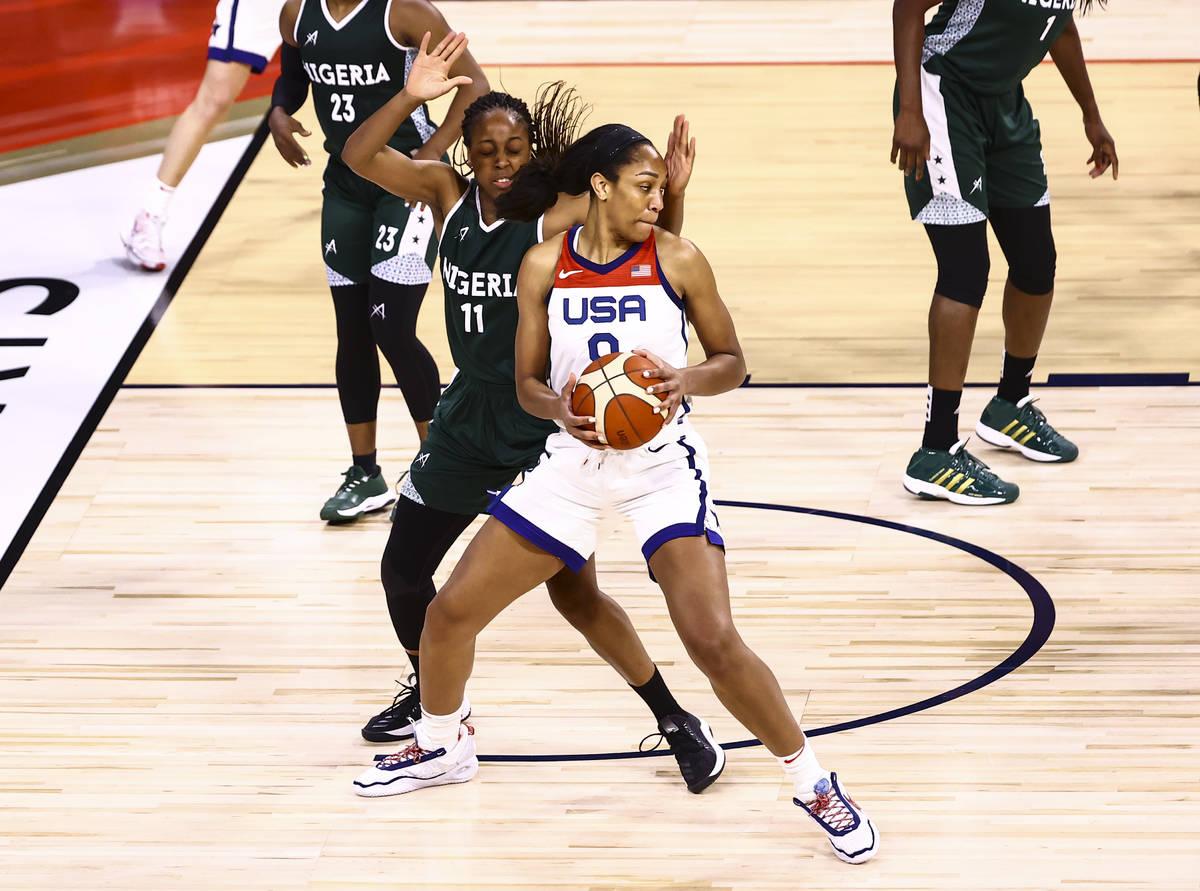United States forward AÕja Wilson (9) moves the ball around Nigeria forward Adaora Elonu ( ...