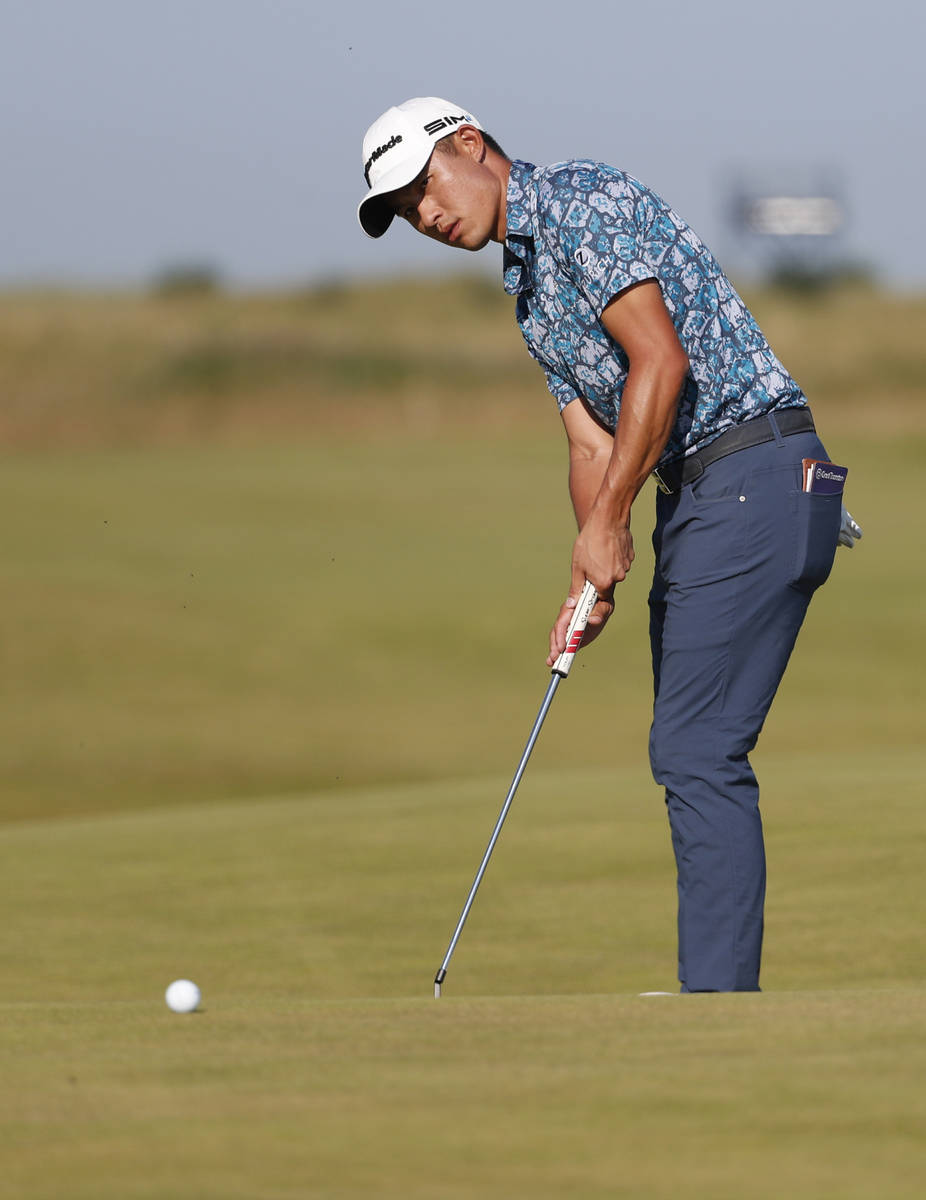 United States' Collin Morikawa makes a birdie putt on the 14th hole uring the final round of th ...
