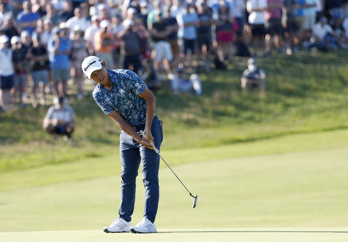 United States' Collin Morikawa reacts after missing a birdie chance on the 17th green during th ...