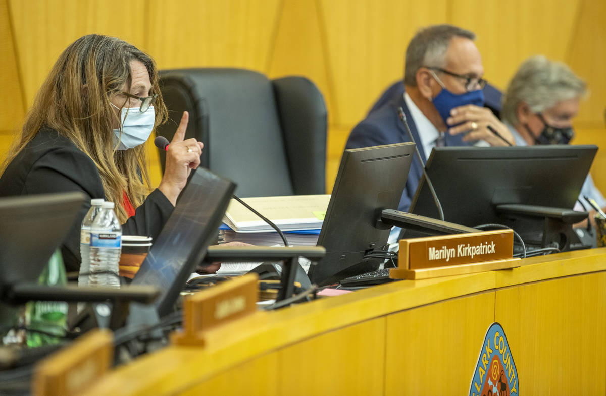 Clark County Commission Chairman Marilyn Kirkpatrick, left, instructs people during public comm ...