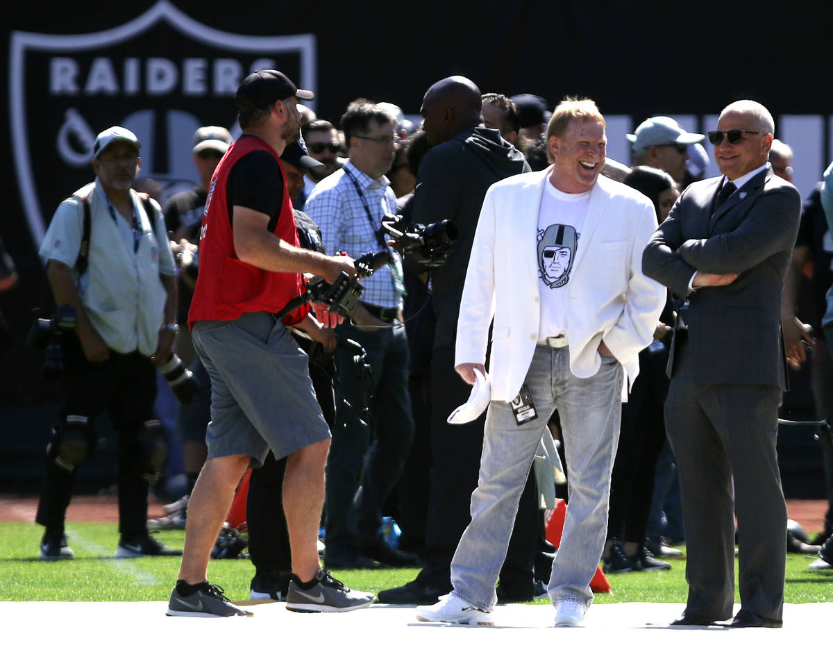 Raiders owner Mark Davis, in white, and president Marc Badain, right, share a laugh before an N ...