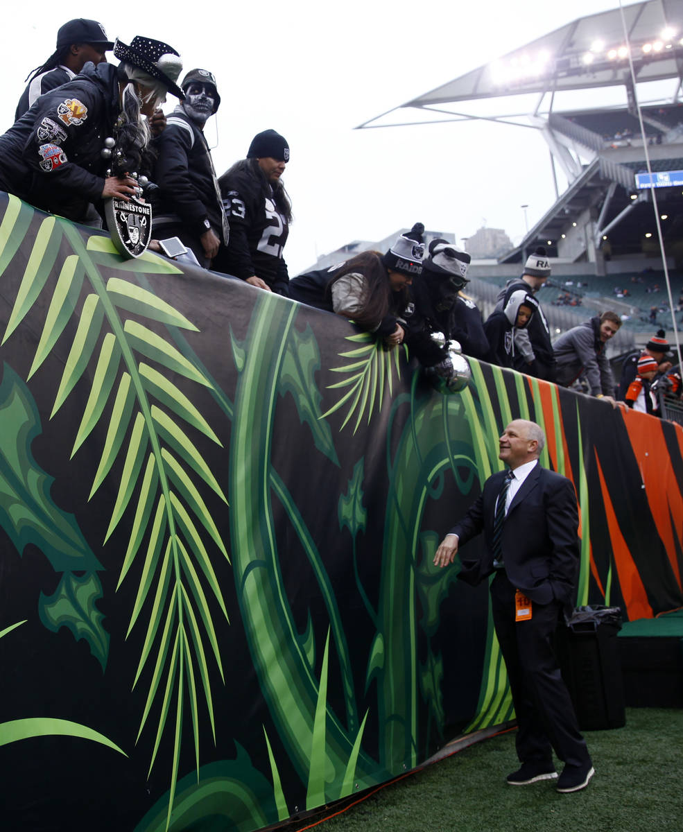 Raiders president Marc Badain meets with the teamճ fans before an NFL game against the Ci ...