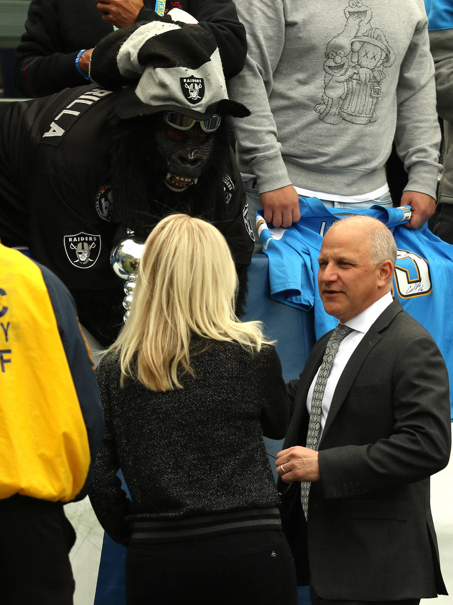 Raiders president Marc Badain meets with one of the teamճ super fans, Gorilla Rilla, befo ...